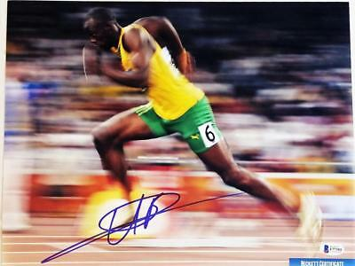 USAIN BOLT SIGNED AUTOGRAPHED 11x14 PHOTO OLYMPIC GOLD MEDALIST BECKETT BAS 393