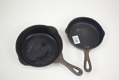 Pair of vintage Lodge cast iron skillets (3 & 4), arc logo, no notches
