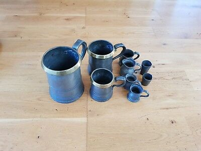 Vintage antique Brass rimmed Pewter Tankards and pewter Pub Measures