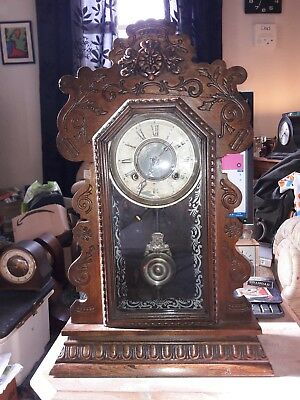 Vintage 1900 ANSONIA Ginger Bread Mantel Clock in Working condition.