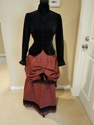 Victorian bustle dress in black velvet and red plaid dress