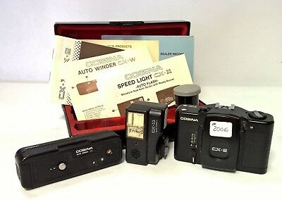 Vintage Cosina CX-2 Camera with Flash and Auto Winder Attachments in Case