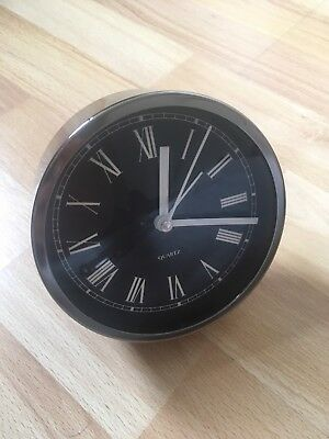 Beautiful chrome, black and white clock, never used, 1 AA battery required