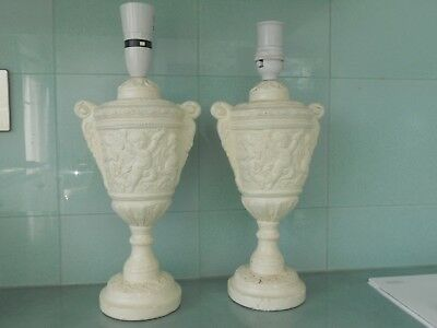 A Large Vintage Pair Of Embossed Cherub Cream Coloured Table Lamps - 36 Cms Tall