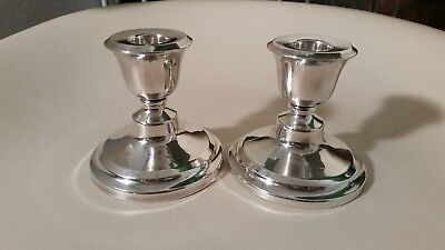 solid silver pair of candlesticks
