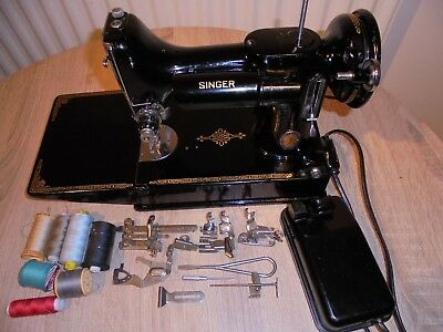 """Singer 221K Featherweight Centennial Badge Sewing Machine"""" with attachments."""