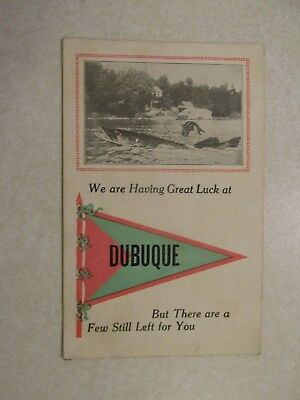 F184 Postcard Greetings from Dubuque Iowa IA huge fish exaggeration flag