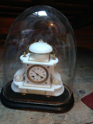 French antique alabaster and gilt mantle clock with dome and wooden base