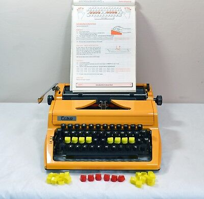 Typewriter Erika German Vintage 1976. With typing course and coloured keys.