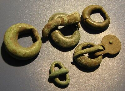 Ancient fragments of clasps of clothing  Viking. Bronze. Original.