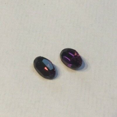 A pair of amethyst paste stones 7 x 5 mm
