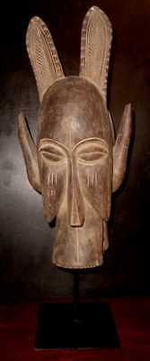 Vintage Senufo Firespitter African Shaman Wooden Funeral Mask On Metal Stand.