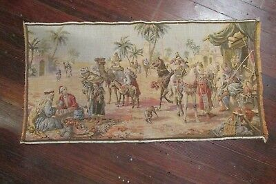 vintage tapestry Middle East scene market people camel horses rifle 37 x 18 1/2""