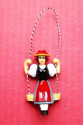 Pendulum,   swinging lady for a small novelty type cuckoo clock.