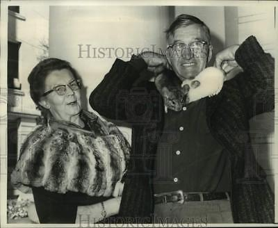 1967 Press Photo Mr. and Mrs. C.B. Jeffers with their pet rabbits on their home