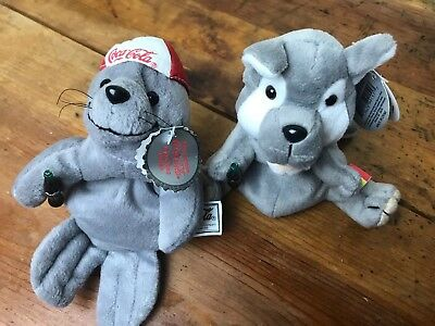 Lot of 2 Coca-Cola Collection, Howls Romania Int & Seal in Cap Bean Bag Plush