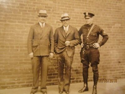 Real Photo of Motorcycle Patrolman with Two Men in Suits
