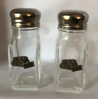 Clear Glass salt and pepper shakers with Bulldozers on them