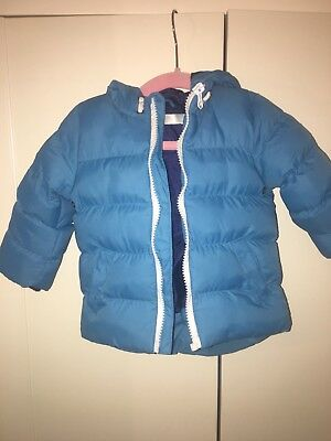 Baby Boy Blue Puffa Jacket in size 6-9 months