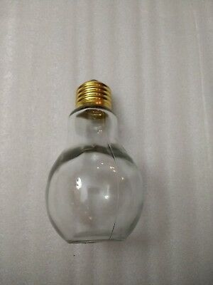 """Clear Light Bulb Salt and Pepper Shakers Gold Twist Top Heavy Glass 4.5"""" Tall"""