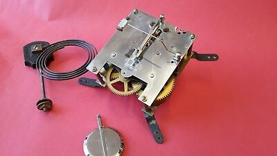 8 Day clock movement, pendulum and gong Chrome plated back plate - H.Samuel