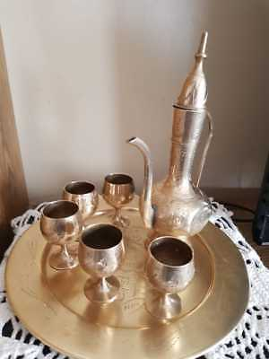A beautiful dallah table with cups old
