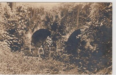 RPPC Men in front of tunnels in rain jungle, Panama, Canal Zone