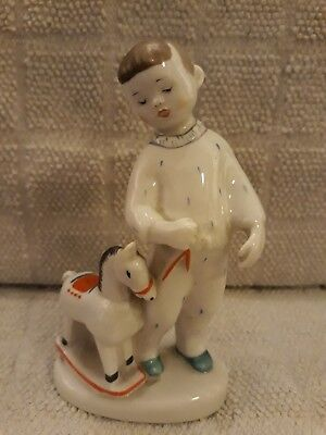 Russian Lomonosov Porcelain Small Child with a Rocking Horse Figurine