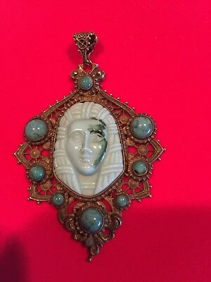 Vintage Egyptian style pendant with turquoise stones and carved center stone.