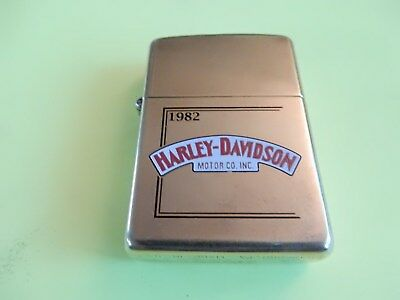 Gold colored 1994 ZIPPO Lighter with 1982 Harley Davidson Logo unfired  very nic