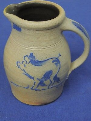 Rowe Pottery Works Pitcher with Pig Design 8""