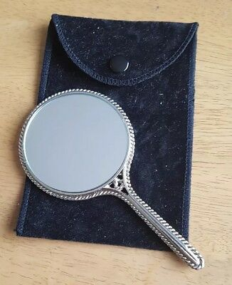 Beautiful. Silver Coloured. Small Hand Mirror With Flower Design On Back.