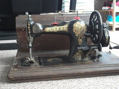 Jones Family C.S. Handcrank Sewing Machine with box lid and key.