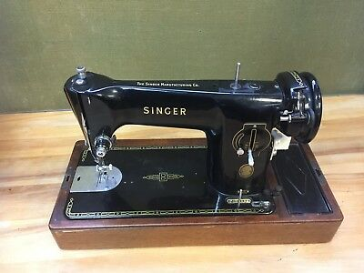 Singer Sewing Machine  - with instructions, spares and lid - untested. 8D