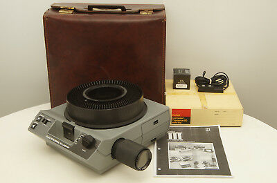 Kodak Ektagraphic III A slide projector with case, tray, remote, and bulb