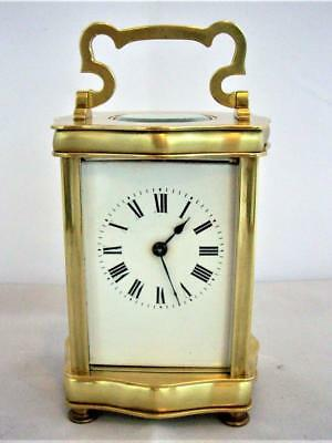 ANTIQUE SERPENTINE FRENCH 8-DAY BRASS CARRIAGE CLOCK  good working order.
