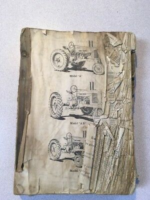 antique John Deere Dealership tractor parts books from the 1940's
