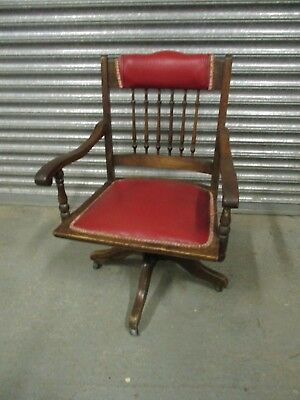 An Edwardian 20th Century Oak Captains Chair Antique Leatherette Red Office