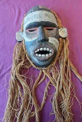 Vintage Decorative African Mask Hanging In Good Condition With String-Like Hair