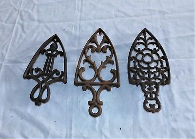 "3 Small Vintage Iron Shaped Trivets, all about 3-1/2"" wide"