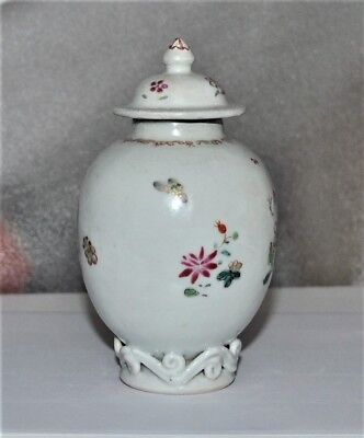 A small and beautiful Chinese porcelain vase with flowers and scrolls at bottom