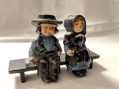 Cast Iron Amish boy and girl figure on a bench