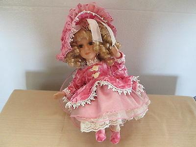 "Adorable 11"" Porcelain Doll - Play music and move"