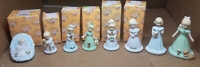 ENESCO Growing Up Birthday Girl Blonde Figurines - Baby to Age 7 - Some boxes.