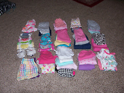 48 girls clothing sizes 9,-12 months lot