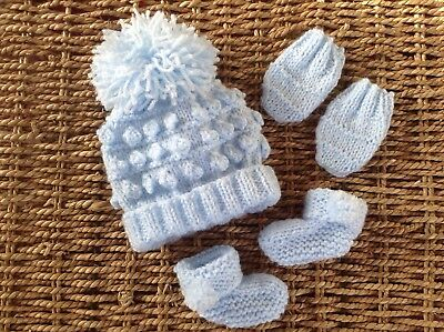 Hand Knitted Newborn Baby Pom Pom Bobble Hat, Mitts And Booties Set In Baby Blue