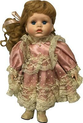 PRE-OWNED Leonardo Collection Pink Outfit 12In Porcline Doll PF207