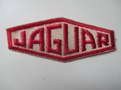 JAGUAR   {  red letters with white  background  }    * sew on patch