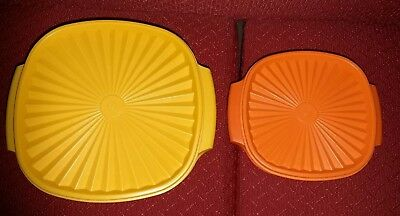 A STUNNING 1960s/70s ORANGE YELLOW PAIR OF VINTAGE PLASTIC TUPPERWARE CONTAINER