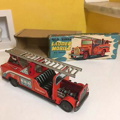 Vintage Nomura, Tin Friction Old Timer Ladder Mobile With Sparking Action W/box!